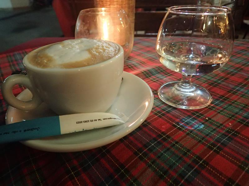 Cappuccino and glass of grappa