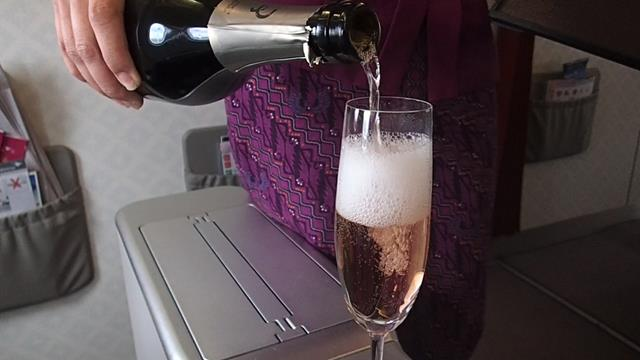 Freshly poured champagne in Garuda Business class
