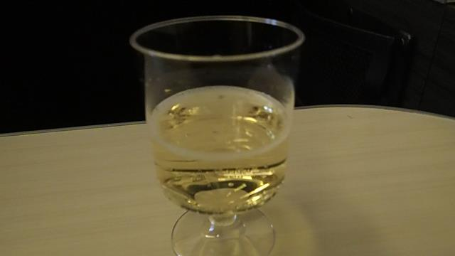 Champagne in a plastic cup on JAL flight
