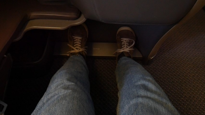 Feet pushed against the seat infront