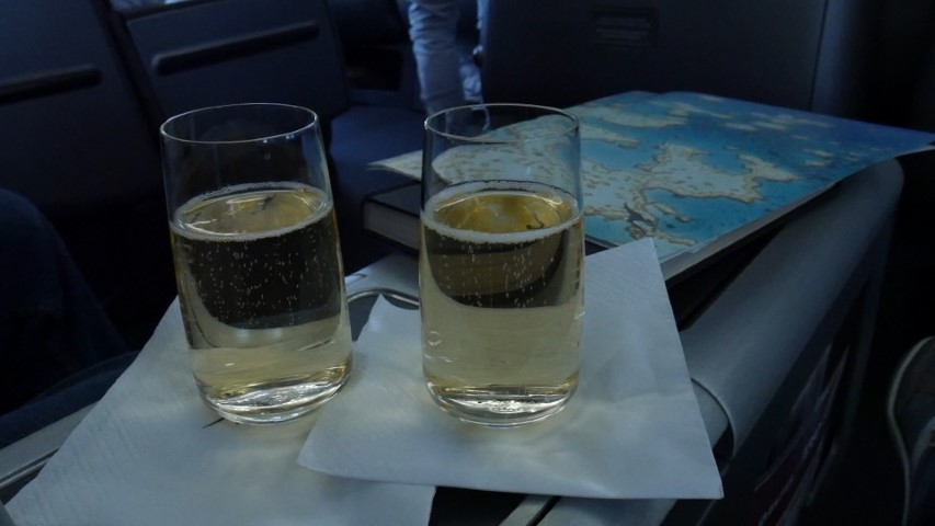 Glass of champagne before take-off