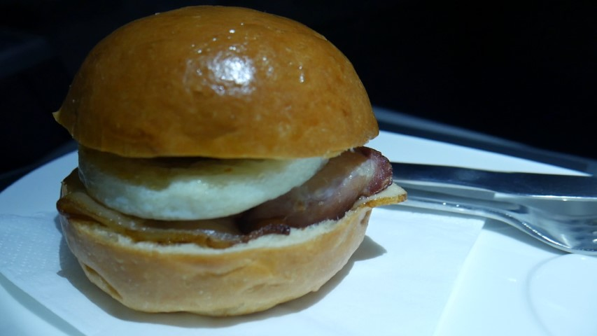 Bacon and egg brioche for breakfast on Qantas QF2