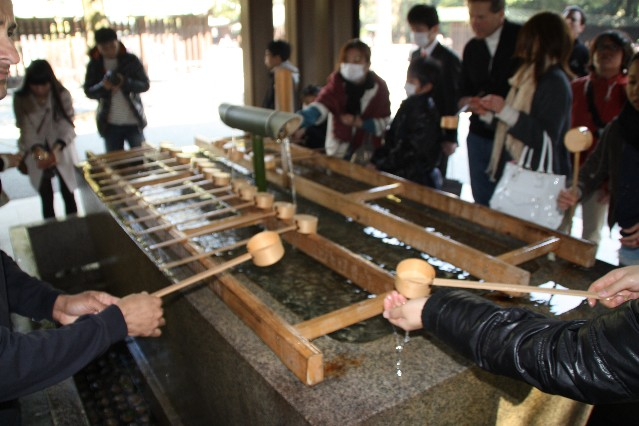 Cleansing before entering Meiji Jingu Shrine Tokyo