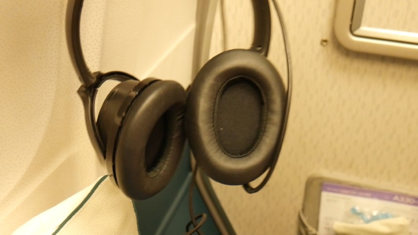 Noise canceling head set on Cathay Pacific Premium Economy