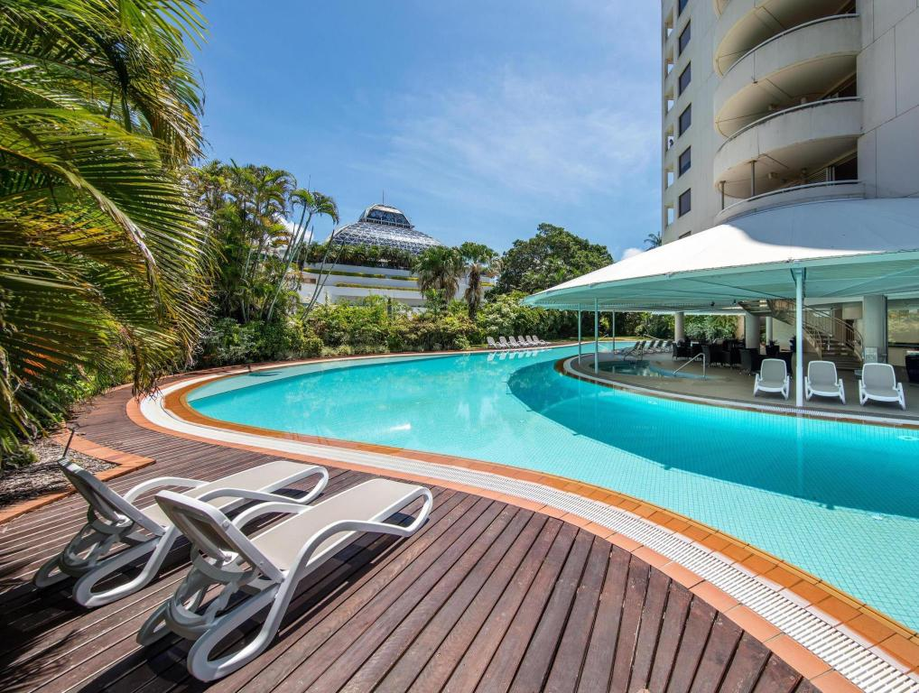 Outdoor swimming pool at Hilton Cairns